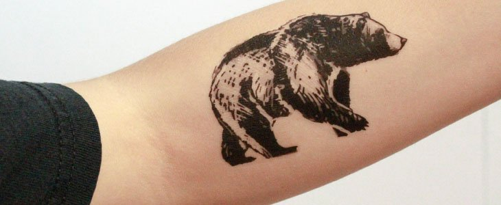 bear tattoo avambraccio