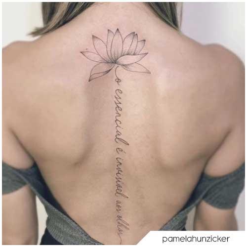 tattoo fiore di loto scritta schiena
