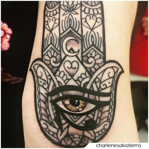 Tatuaggio mano di Fatima evil eye
