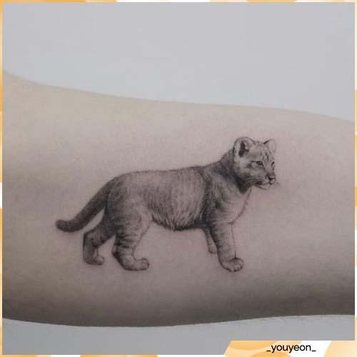 tatuaggio leone cucciolo