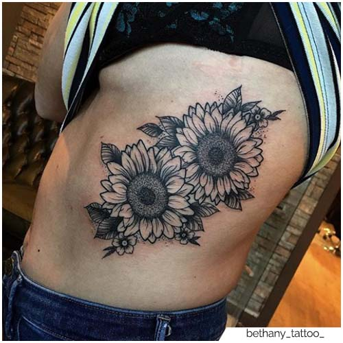 Tatuaje de girasol Costato