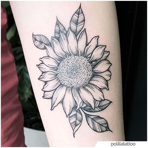 Tatuaje de girasol blackwork antebrazo