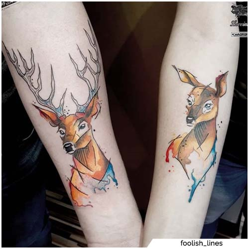 tatuajes de ciervos y pareja trasera