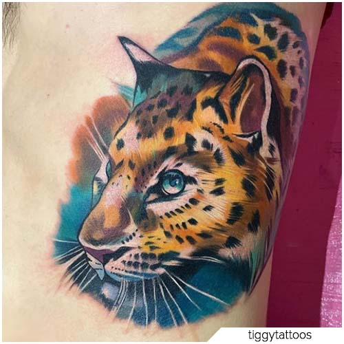 tatuaje de leopardo ralistico