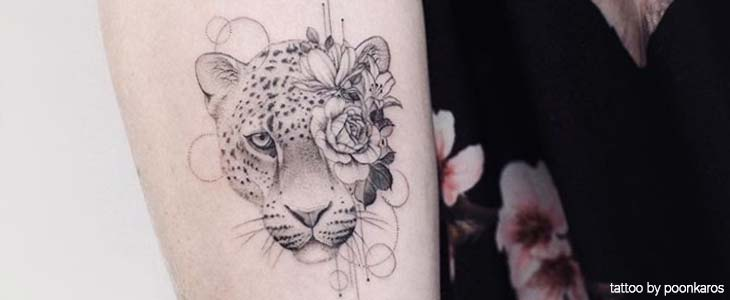 brazo de tatuaje de leopardo
