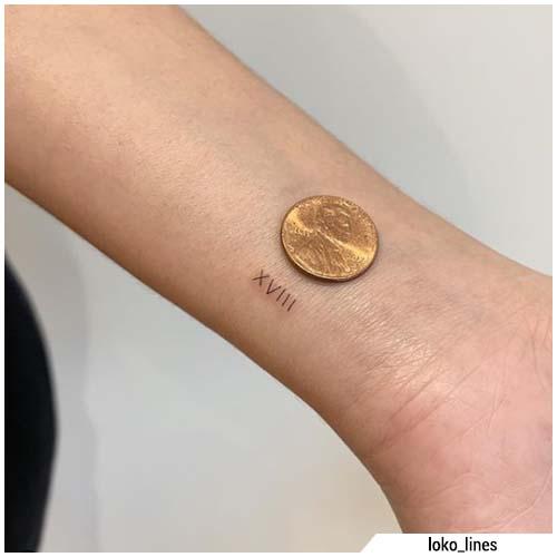 tatuajes de pequeños números romanos
